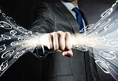 Close up of businessman clenching speech bubbles in fist