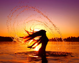 picture of hair motion  - Beauty Model Girl Splashing Water with her Hair - JPG