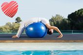 Peaceful brunette in cobra pose over exercise ball poolside against red heart