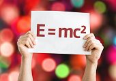 E = mc2 card with colorful background with defocused lights