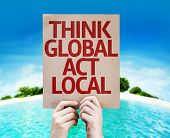 Think Global Act Local card with a beach on background