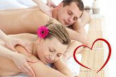 Relaxing couple having a massage against heart