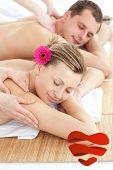 Adorable couple having a massage against heart