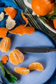 Top Table View On Peeling Organic Clementines
