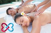Attractive couple enjoying couples massage poolside against linking hearts