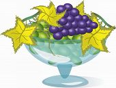 Glass vase with grape.