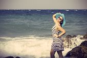 Beautiful Woman Splashing In The Sea. Vintage Style