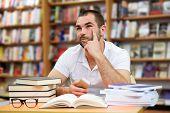 Portrait Of Pensive Man In A Bookstore