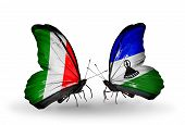 Two Butterflies With Flags On Wings As Symbol Of Relations Italy And Lesotho