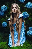 Sexy Blond Woman In Blue Dress With Flowers
