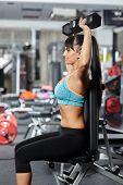 Fitness Girl Doing Shoulder Workout
