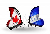 Two Butterflies With Flags On Wings As Symbol Of Relations Canada And Honduras