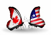 Two Butterflies With Flags On Wings As Symbol Of Relations Canada And Liberia