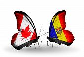 Two Butterflies With Flags On Wings As Symbol Of Relations Canada And Moldova