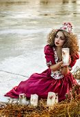 Beautiful girl in vintage red dress with a rose
