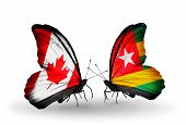 Two Butterflies With Flags On Wings As Symbol Of Relations Canada And Togo