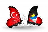 Two Butterflies With Flags On Wings As Symbol Of Relations Turkey And Antigua And Barbuda