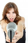 Hairdresser Holding Hairdryer Like Gun And Pointing At Camera Wiith Astonished Face Expression