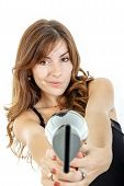 Hairdresser Holding Hairdryer Like Gun And Pointing At Camera Wiith Curious Face Expression