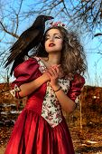 Beautiful woman in vintage red dress with a black