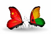 Two Butterflies With Flags On Wings As Symbol Of Relations China And Guinea Bissau