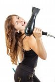 Smiling Professional Female Hairdresser Holding Hairdryer