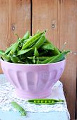 stock photo of snow peas  - Fresh pea pods in the bowl - JPG