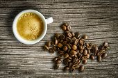 pic of food chain  - Retro Style Image Of A Cup Of Espresso Coffee With Some Organic Coffee Beans On A Rustic Table - JPG