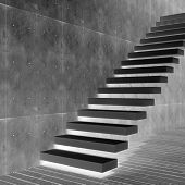 Concept or conceptual black stone or concrete stair or steps near a wall background with wood floor