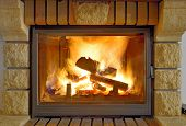 stock photo of cozy hearth  - Roaring flames in a modern fireplace - JPG