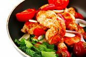 chicken with tomatoes and hot peppers on pan