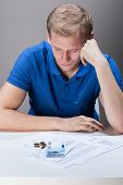 Young Man Having Financial Problems