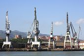 stock photo of blunt  - Bilbao Industrial Cranes dock port blunt heavy - JPG
