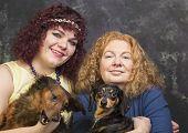 Stylish women with pets