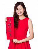 Woman hold with china fai chun, phrase meaning is blessing for good health