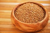 buckwheat at wooden plate on wooden background