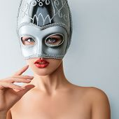 picture of incognito  - Beautiful young woman in mysterious venetian carnival mask - JPG