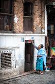 Woman Doing Ritual In Nepal