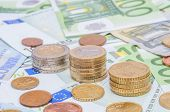 Euro Banknotes And Euro Coins In Simple Example