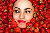 woman face in strawberries