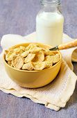 Bowl Of Cornflakes And Bottle Of Milk
