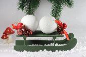Green wooden sleigh with snowballs