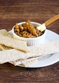 image of crisps  - Crisps and spicy eggplant dip selective focus - JPG