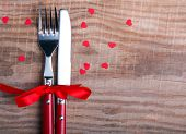 Knife And Fok And Little Red Hearts On The Wooden Table.