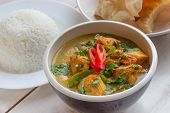 stock photo of curry chicken  - Indian green curry with chicken basmati rice and papadums - JPG