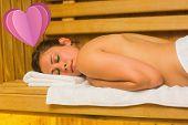 Calm brunette lying down in a sauna against heart