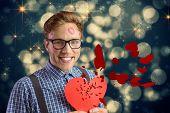 Geeky hipster covered in kisses against shimmering light design on black