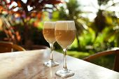 spanish coffee latte in tall glasses with morning sunny background