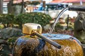 foto of trough  - Purification trough with dipper arranged in front of Shinto shrine Japan - JPG