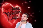 Happy casual man thinking with hand on chin against valentines heart design